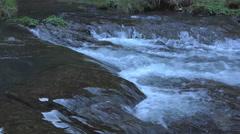 Closeup stream passing over rocks Stock Footage