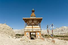 Stock Photo of Colorful ornate Buddhist stupa at the entrance to the village gate stupa