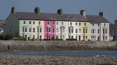 Zoom out, houses along street on the coast at beaumaris, anglesey, wales, uk Stock Footage