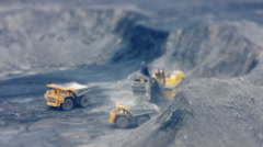 Stock video footage huge dump trucks like toys tilt shift Stock Footage