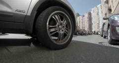 2k side view of metallic disk wheel on car driving through the house parking Stock Footage