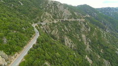 Flying over winding mountain road in sardinia, italy Stock Footage