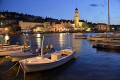 Fishing boats in the harbour of Sutivan front of the Sveti Ivan Church Sutivan Stock Photos