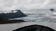 First person view from the zodiac boat approaching the glacier, Iceland Stock Footage