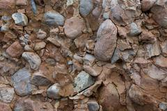 Iron oxide containing sediment conglomerate out of the rubble of the - stock photo