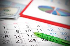 Workplace with calendar Stock Photos