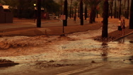 Stock Video Footage of 4K UHD flooded streets area sunset colors reflection heavy flow monsoon zoom in