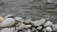 Rapid shallow river and the pebble shore Stock Footage