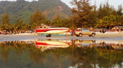 Kamala, thailand - circa mar 2014: leisure boat pulled from the water and tak Stock Footage