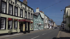 Tourists walk along castle street, beaumaris, anglesey, wales, uk Stock Footage