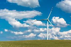 Wind farm on rural terrain Stock Photos