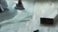 Carpenter worker installing wood glue for parquet board during flooring Stock Footage