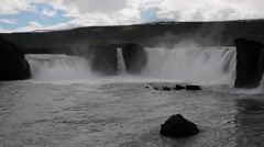 Famous Godafoss waterfall on a sunny day, Iceland Stock Footage