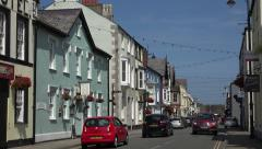 Cars drive along castle street in beaumaris, anglesey, wales, uk Stock Footage