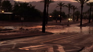 Stock Video Footage of 4K UHD flooded streets area sunset colors reflection heavy flow monsoon wide