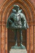 Stock Photo of Bronze statue monument to William the Silent in front of the neo Gothic