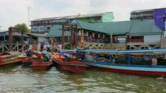 Ranong, thailand - circa mar 2014: comes loaded on boats to move to myanmar Stock Footage