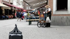 Senior man playing a street organ in the old town. Stock Footage