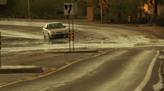 4K UHD flooded street monsoon traffic hazard storm rain deep splash danger 2 Stock Footage