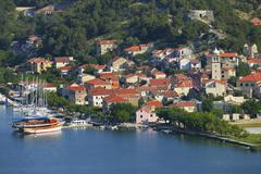 Townscape with sailing ship in the foreground River Krka Skradin Dalmatia Stock Photos