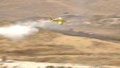 Yellow fire fighters , Agriculture Aircrafts , crop dusters  put the fire out Stock Footage