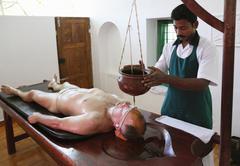 shirodhara, oil being poured on the forehead, ayurvedic treatment, bethsaida  - stock photo
