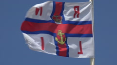 Rnli lifeboat station flag against blue sky Stock Footage