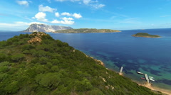 Flying over green hills on sardinia's eastern coast Stock Footage