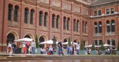 Tourists enjoy the V&A garden, London 4K Stock Footage