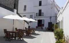 Little alleyway with seats of a restaurant in the small town of vejer de la f Stock Photos