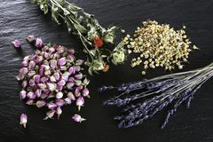 Dried flowers, lavender (lavandula angustifolia), safflower (carthamus), rose Stock Photos