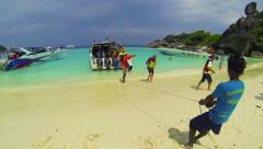 Similans, thailand - circa mar 2014: tourists come ashore under the direction Stock Footage