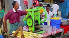 Yangon, myanmar - 03 jan 2014: sellers of cane juice on the streets Stock Footage