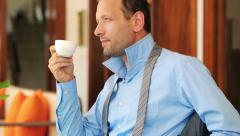 Businessman enjoying tasty coffee by the table at home HD - stock footage