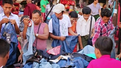 Yangon, myanmar - 03 jan 2014: sale of cheap clothes on the street Stock Footage