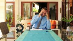 Young businessman having headache during work at home HD Stock Footage