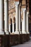 arcade with columns at the plaza de espana square in seville, andalusia, spai - stock photo