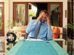 Young businessman having headache during work at home NTSC Stock Footage
