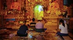 Yangon, myanmar - 03 jan 2014: people pray at the temple. golden pagoda Stock Footage