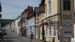Tourists walk along street, beaumaris, anglesey, wales, uk Stock Footage