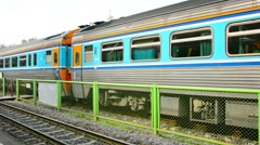 Authaya, thailand - circa nov 2013: departing passenger train at the station. Stock Footage
