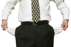 businessman with empty pockets - stock photo