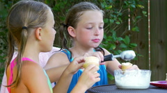 Little girls eating lots of ice cream 4k Stock Footage