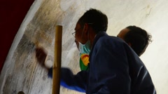 Bagan, myanmar - circa jan 2014: professional restorers working with painting Stock Footage