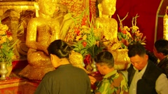 Bagan, myanmar - circa jan 2014: visitors of the buddhist temple covered budd Stock Footage