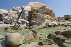 Stock Photo of bizarre granite rock formations and monoliths on the beach, capo ceraso, sard