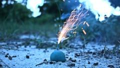 Small Blue Smoke Bomb Firework Close Up - stock footage