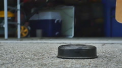 Street hockey puck hit Stock Footage