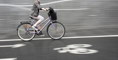 Cyclist on purple bike Stock Photos