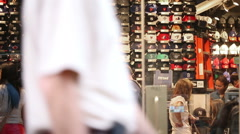 Famous Lids Hat Store in Times Square New York City NYC Slow Motion People - stock footage